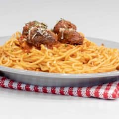 Easy recipe for how to make classic spaghetti and meatballs. Oven baked meatballs with a bright marinara sauce.