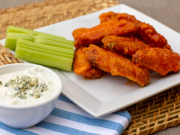 Restaurant style buffalo chicken wings made at home. Easy to prepare wings with a traditional hot and spicy sauce. Great deep fried tail gate party snack.