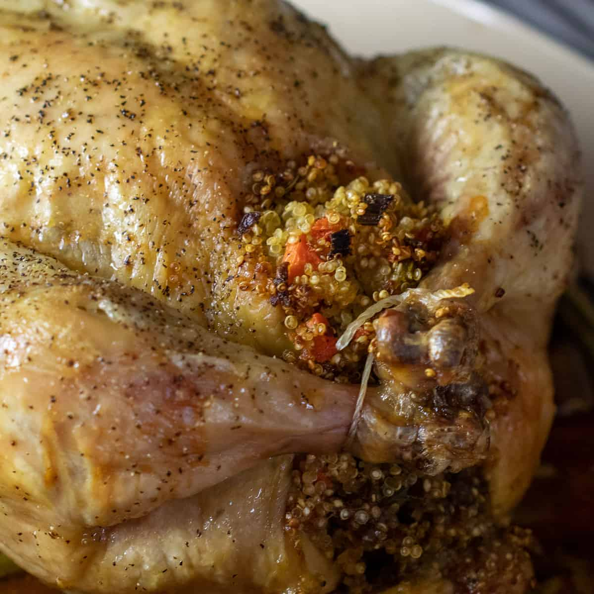 A close up picture of the stuffing and legs of the chicken.