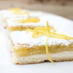 The shortbread base is the perfect crust and the tangy yet sweet lemon filling is to-die-for. As it bakes a thin crispy layer if formed on top of the filling.