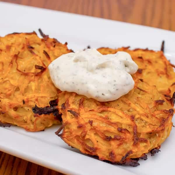 This sweet potato pancake (latkes) recipe has a wonderful combination of sweet and spice. They are baked instead of being fried so they are a healthy option for people celebrating Hanukkah.
