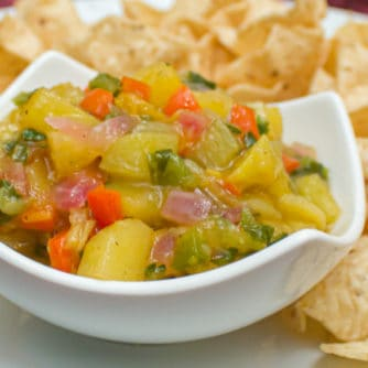 A fresh fruity salsa with a Mexican kick of cumin and jalapeno peppers. This bright peach and mango salsa goes great with nacho chips.