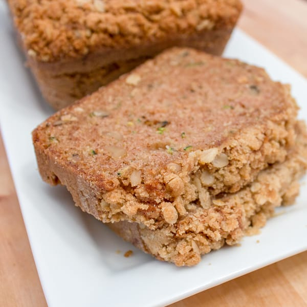 A moist zucchini loaf with cinnamon, and a hint of nutmeg and cloves. Topped with a crumble topping of oats, brown sugar, butter and cinnamon. Delicious!!