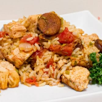 Instructions for how to make jambalaya. This classic Cajun and Creole dish uses chicken and andouille along with onions, celery and peppers and baked with rice.
