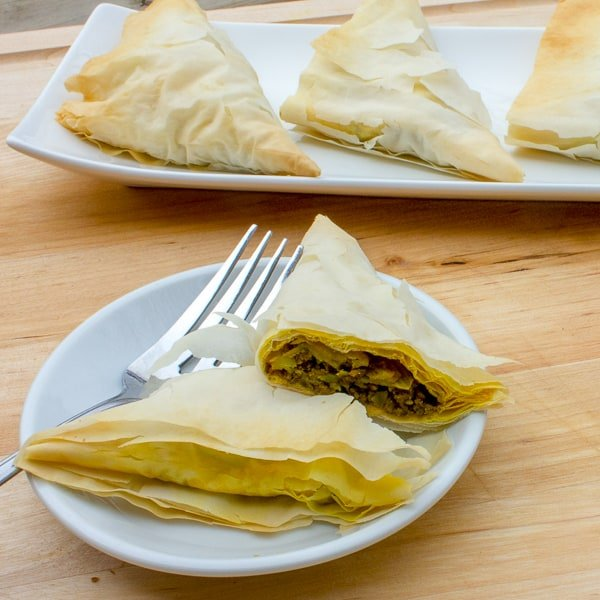 These bite size appetizers are the perfect party food. The curry beef recipe is packed with flavour and the phyllo pastry is flaky and light. On top of that, they are a snap to make!