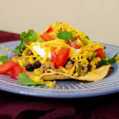 A fresh take on a Mexican classic. This healthy option uses ground chicken, black beans and corn in the meat mixture instead of ground beef. Top it with cheese, tomatoes, sour cream and guacamole and you have a winner!