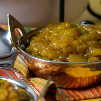 A bowl of mango chutney in an Indian style dish.