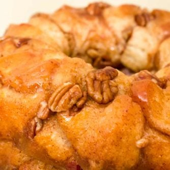 How to make monkey bread recipe with Pillsbury biscuit tubes and then has a caramel mixture that is poured over top and coats the pecans and monkey bread.