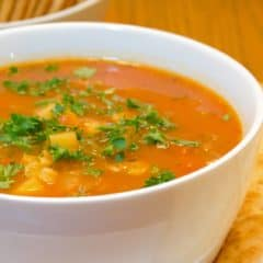 This Manhattan version of clam chowder soup recipe has a tomato broth with potatoes, celery and onions. You can use fresh, canned or frozen clams. The soup is easy to make and it tastes delicious!
