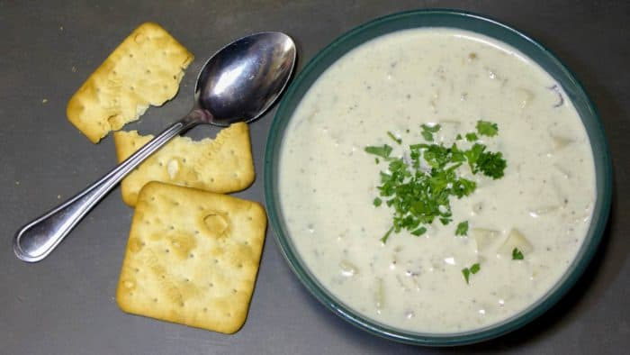 This New England Clam Chowder is rich and creamy. There are lots of minced clams and cubed potatoes in this hearty soup and the heavy cream make the broth silky smooth.