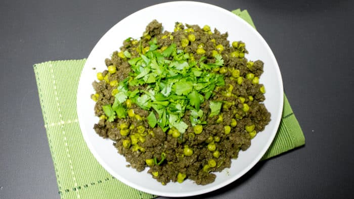 Minced beef and peas in an Indian curry sauce with fresh cilantro. Garam masala, cardamom pods, cumin, chilies, ginger and garlic make up this curry paste.