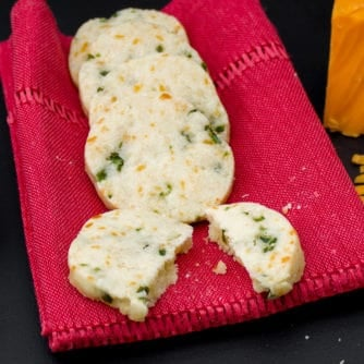 Minced jalapeno pepper and grated cheddar cheese are mixed with shortbread cookie dough to create this savory cookie recipe. These icebox cookies are chilled, cut and then baked.