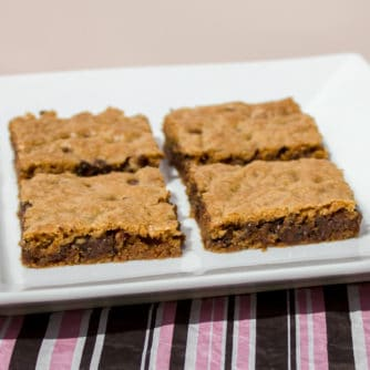Classic chocolate chip recipe with Skor butter crunch toffee pressed on a sheet, baked and cut into bars. These cookie squares go great with coffee or milk.