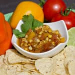 A fresh salsa with tomatoes, corn, onions, sweet peppers, jalapeno peppers, cumin and cilantro. A great Mexican appetizer to go with nacho tortilla chips.