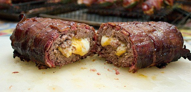 This recipe uses ground beef stuffed with cheddar cheese and shaped into a log. The beef is then wrapped by a bacon weave and smoked until cooked and gooey! Great tailgate food!