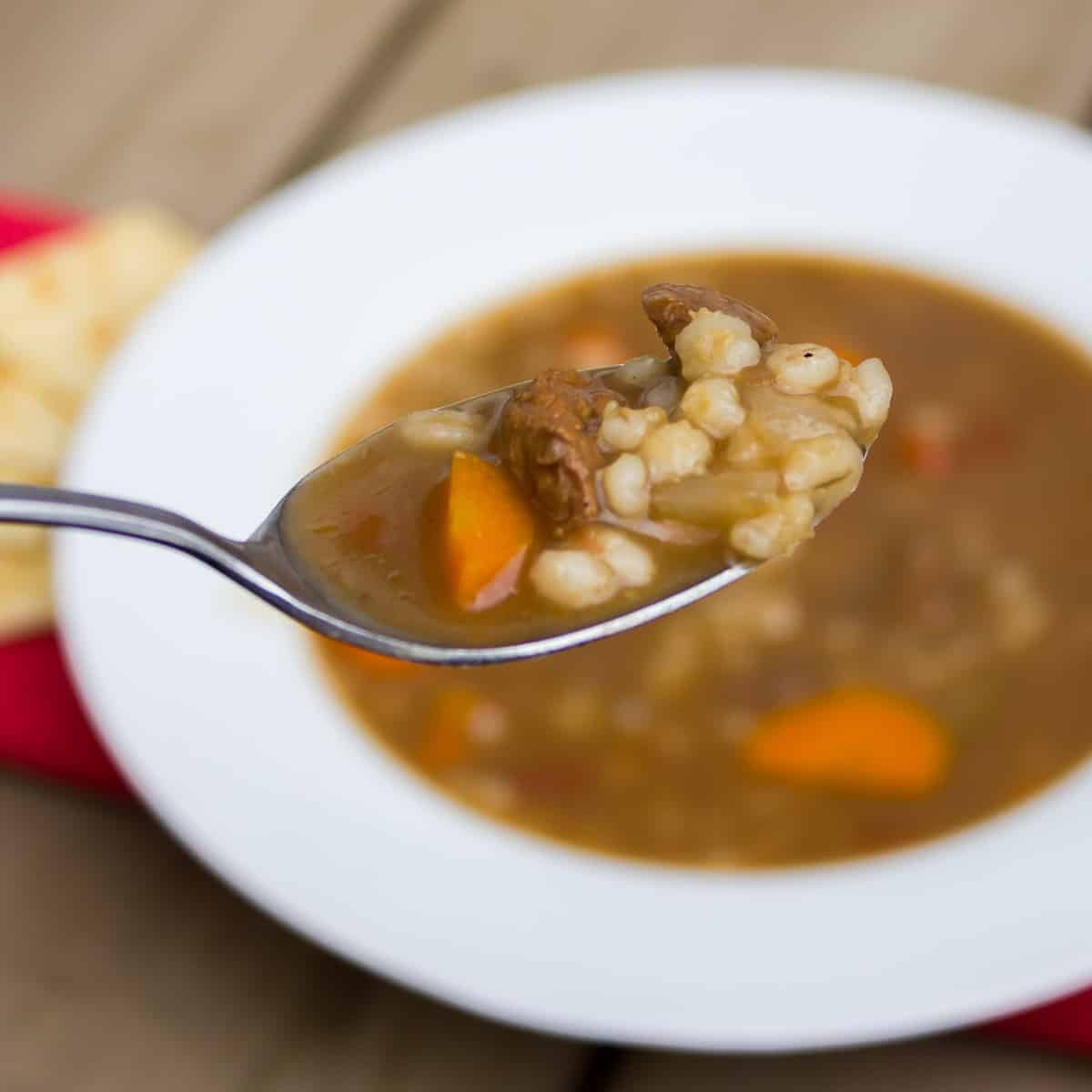 A spoonful of hearty soup that is perfect for a cold winter day.