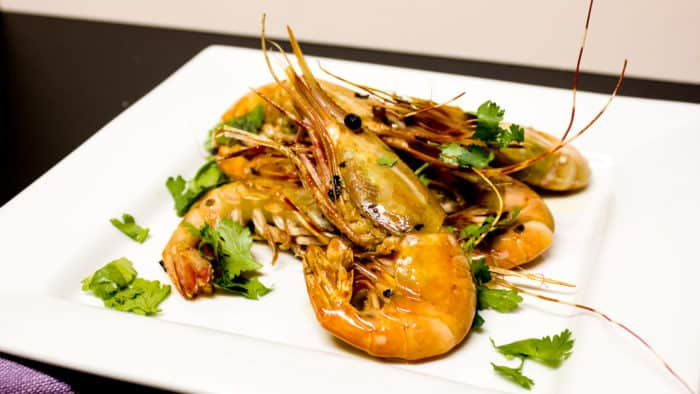 Easy to prepare king prawns cooked in a skillet with Thai chilies, garlic and oil with a cilantro garnish. Australian and Asian seafood similar to shrimp.