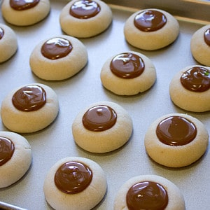 ... dulce de leche in each thumbprint. Drizzle some melted chocolate on