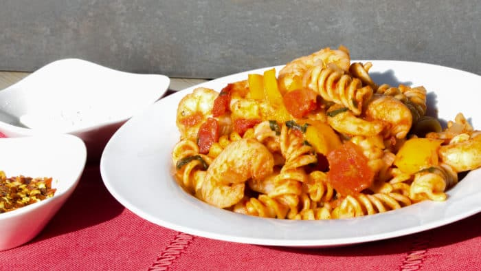 Shrimp pomodoro with rotini pasta. Easy Italian tomato based marinara sauce with white wine, peppers, onions, celery and garlic with tender shrimp as the seafood.