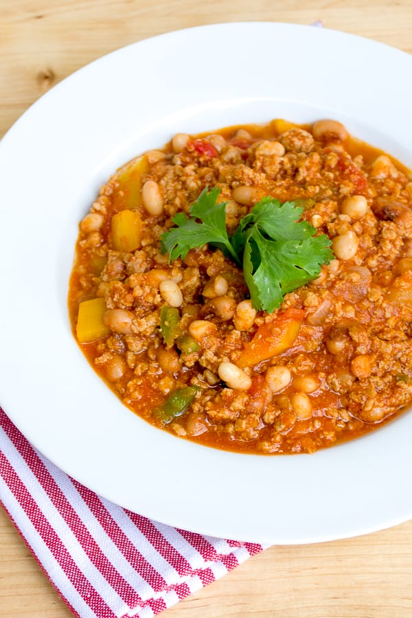 A smokey chili recipe made with ground pork, black eyed peas, yellow peppers and jalapenos. Chipotle powder and smoked paprika provide a deep smokey flavour.