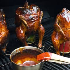 Classic beer can chicken done on the grill. Easy recipe for BBQ chicken. with a rub and sauce