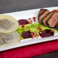 Duck Breast and Cognac Duxelle Wonton Ravioli Recipe with Pomegranate Cognac Sauce and Basil Pesto.