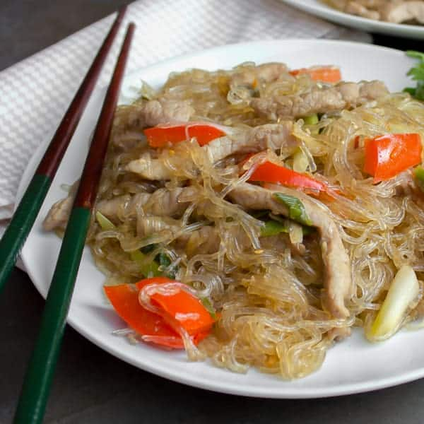A Thai inspired dish with pork, red peppers and green onions/scallions and glass noodles. Also known as crystal noodles, cellophane noodles or Chinese noodles, these are made with bean or peas.