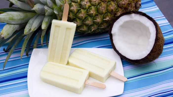 Pina Colada Creamsicle with fresh pineapple, coconut milk, and rum extract. This popsicle is the perfect cool treat on a hot summer day!