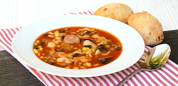 Minestrone soup recipe made with smoked sausage, andouille or kielbasa. Black beans, corn, peas and pasta noodles in the soup with a tomato based broth.