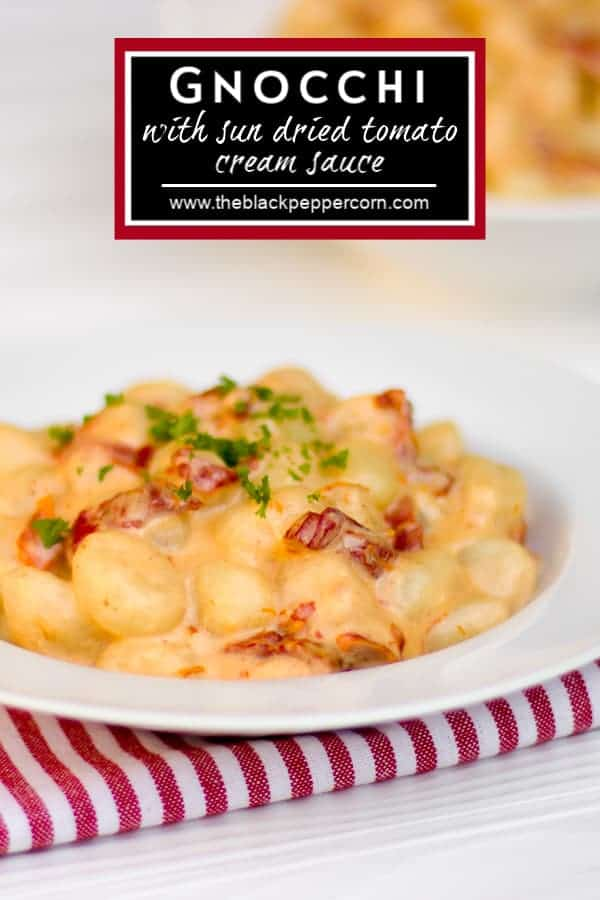 A recipe for a simple cream sauce for potato gnocchi that can easily be made on a weeknight after work. The sun dried tomatoes give great flavour and the parmesan cheese and cream make the sauce silky smooth.