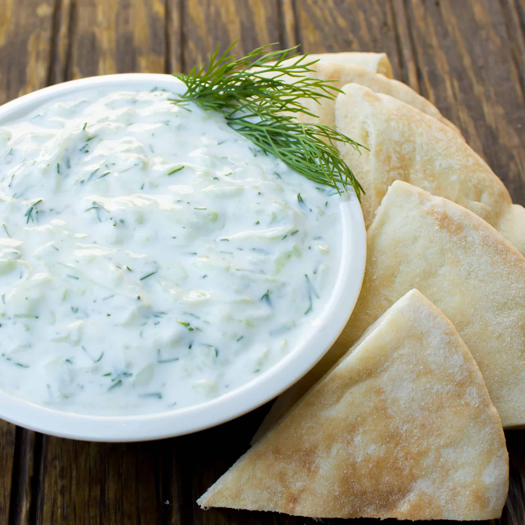 Greek tzatziki recipe with yogurt, cucumber, garlic, lemon juice and dill. Great with souvlaki, gyros or alongside hummus and pita bread.