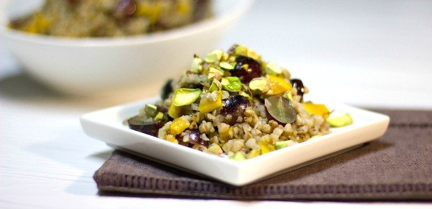 A gluten free salad made with kasha (roasted buckwheat), grapes, dried mango, pistachios and a honey lime dressing.