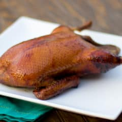 Smoked whole duck with a honey balsamic glaze with mesquite or hickory wood.