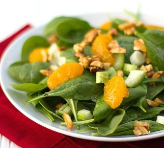 This bright and fresh salad recipe is filled with spinach, celery, green onions, mandarin oranges and candied almonds.