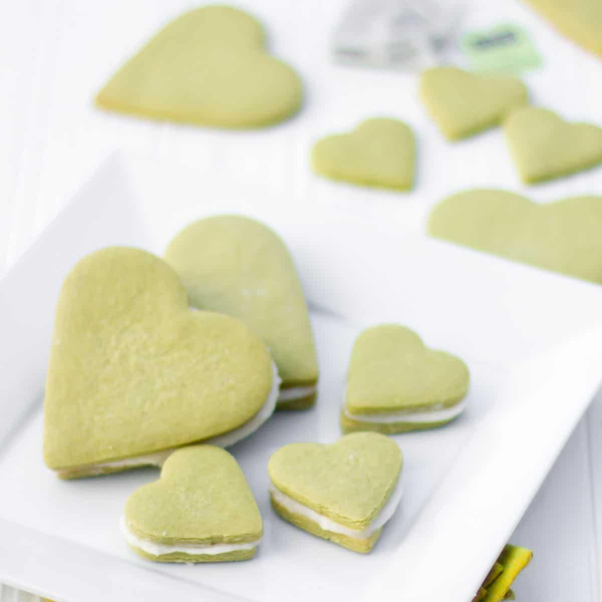 A plate of heart shaped sandwich sugar cookies