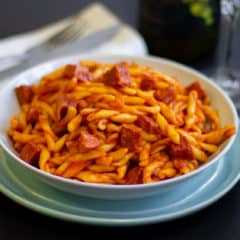 Rustic Italian pasta sauce recipe made with pancetta, mortadella and soppressata salami. Fresh tomatoes, basil, onion and peppers sweeten the sauce.