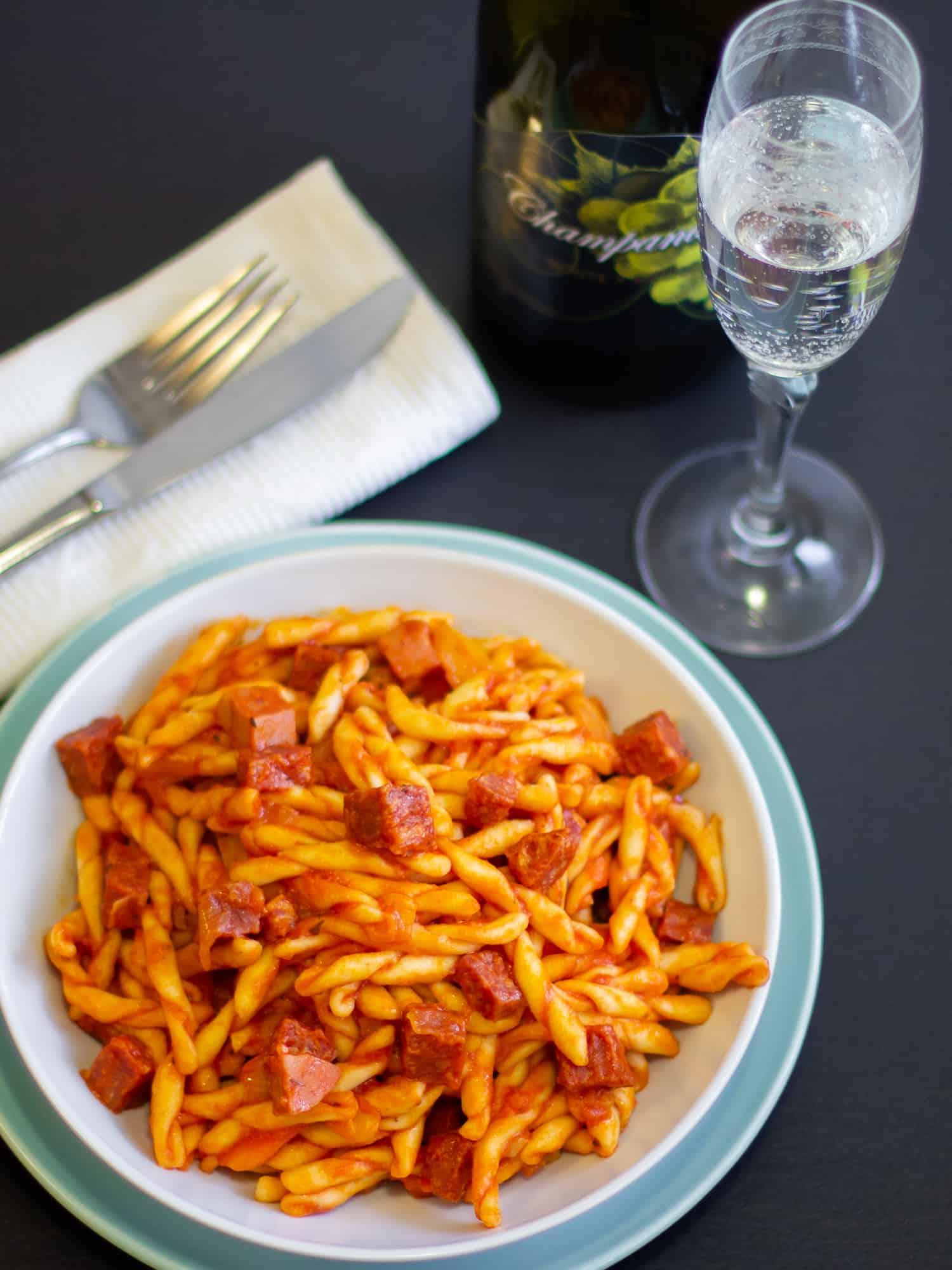 Rustic Italian pasta sauce recipe made with pancetta, mortadella and soppressata salami. Fresh tomatoes, basil, onion and peppers sweeten the sauce.