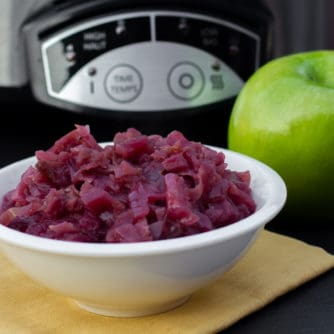 Slow braised red cabbage and apples this German side dish is perfect for the crock pot. Red cabbage, apples, vinegar, onion, sugar. Classic slow cooker recipe.