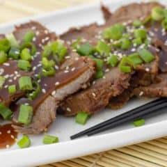 Simple slow cooker recipe for how to cook a beef roast in a crock pot. Boneless ribeye roast with a sweet Asian sesame marinade. Serve on rice with stir fried vegetables.