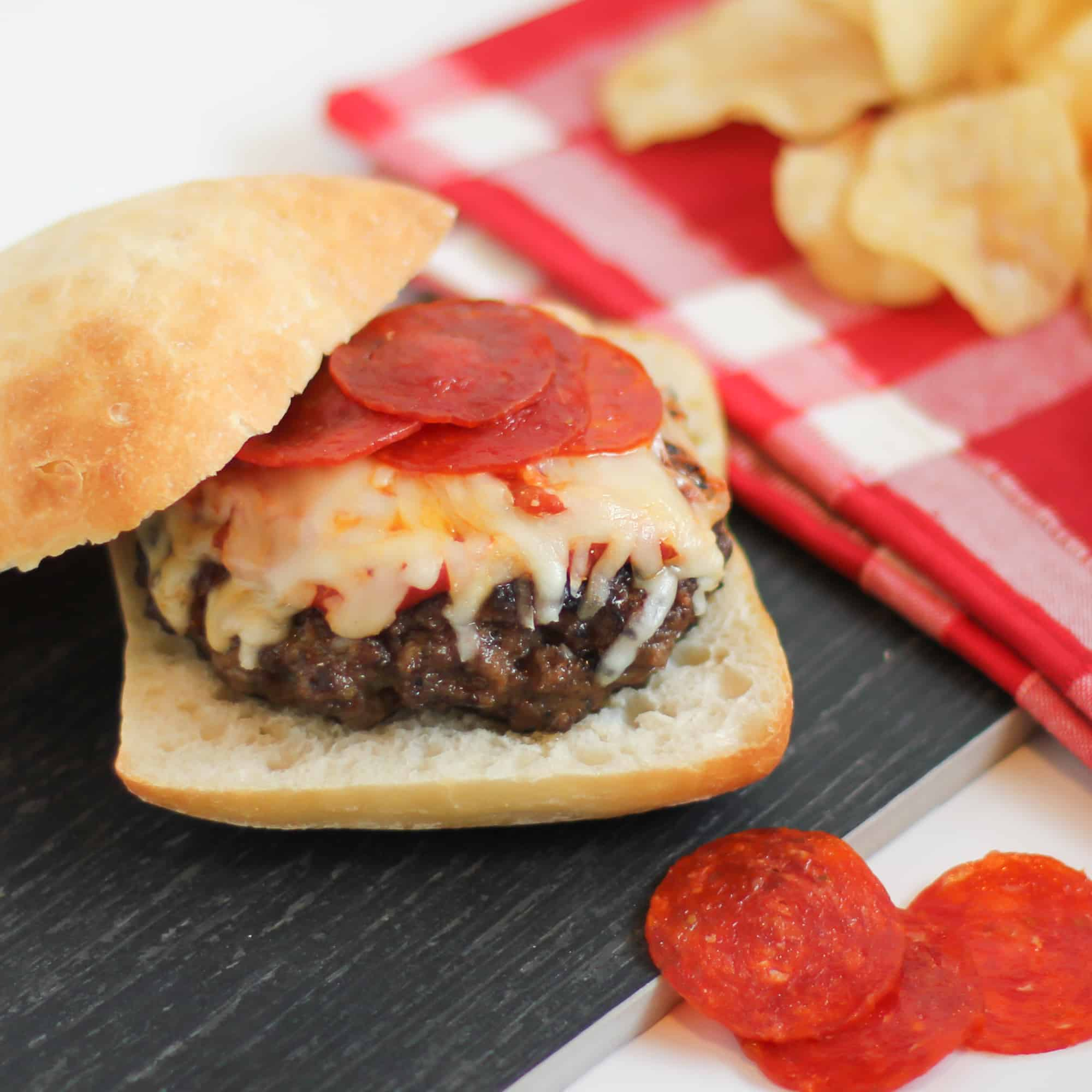 A homemade burger with pepperoni pizza toppings