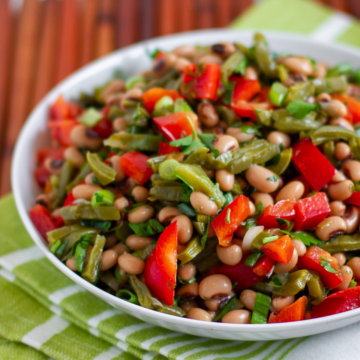 A bright and fresh Mexican salad made with nopalito cactus, black eyed peas, red pepper, green onions, cilantro, lemon juice and olive oil.