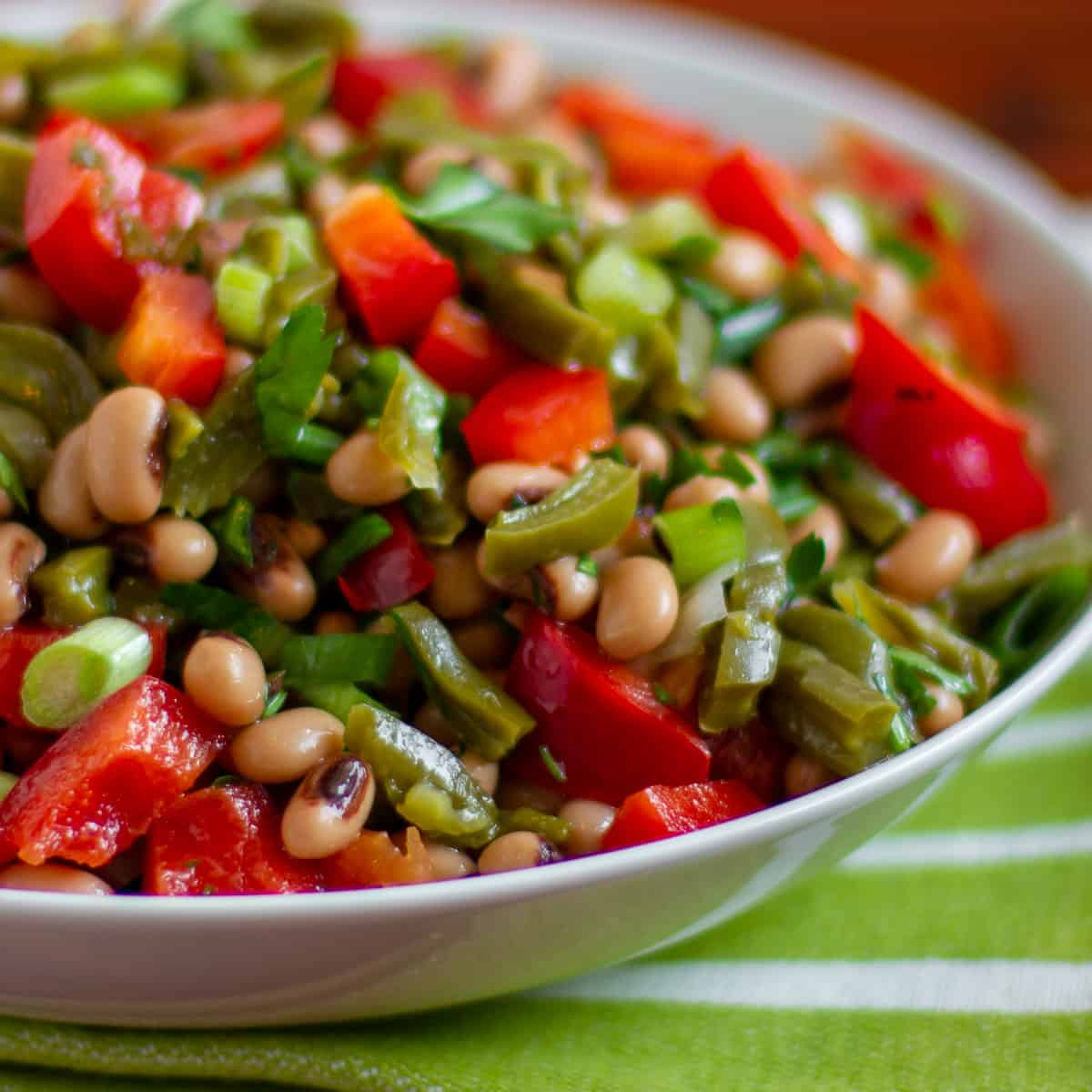 A bowl of Mexican inspired salad with prickly pear cactus and black eyed peas