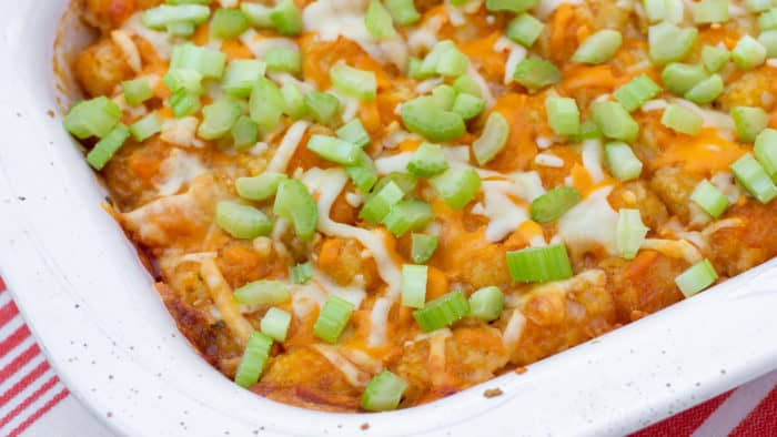 Great pub food and \ comfort food combined. Buffalo chicken with blue cheese covered with Tater Tots and grated cheese. Baked and then topped with celery before serving.