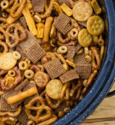 Make Bits and Bites mix at home with this simple recipe. Shreddies, Cheerios, Cheese Bits, Ritz, Pretzels, Chex and mixed with butter, worchestershire sauce, tabasco and spices