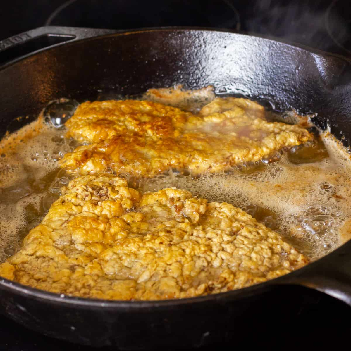 Fry in a cast iron skillet with oil until golden brown.
