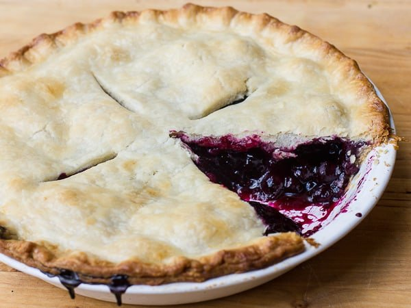 Traditional country pie pastry made with lard and a filling made of fresh blueberries, sugar, tapioca and lemon juice. Flaky, tender and delicious. Easy instructions for how to make this homemade pie.
