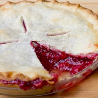 Traditional country pie pastry made with lard and a filling made of fresh raspberries, sugar, tapioca and lemon juice. Flaky, tender and delicious.