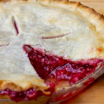 Fresh baked fruit pie with a slice removed