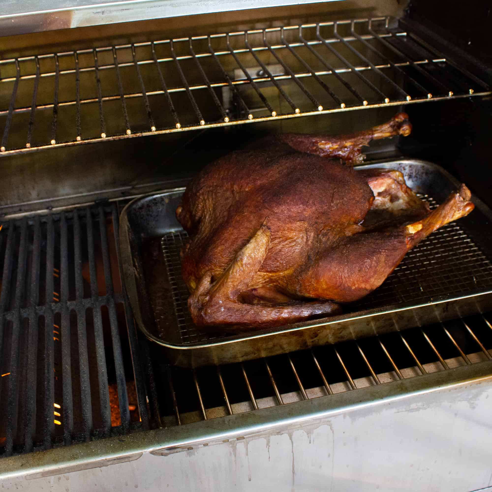 Grilling a turkey is an excellent way to cook the thanksgiving bird. Great recipe for wood, charcoal and gas grills to cook using indirect grilling.