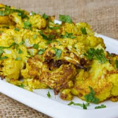 Roasting cauliflower brings out the sweet caramelized flavor of each floret. Toss with curry powder, garlic powder, turmeric and oil. Then squeeze lemon juice and sea salt.